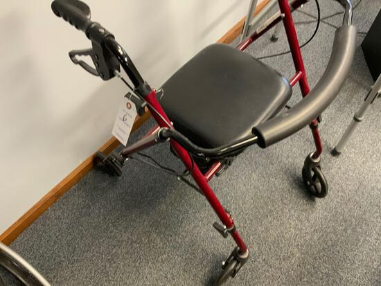 Walker with brakes and seat