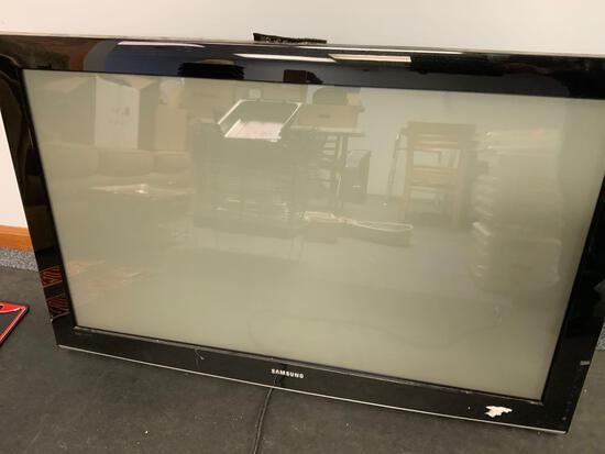Samsung TV with minor scratches on the screen