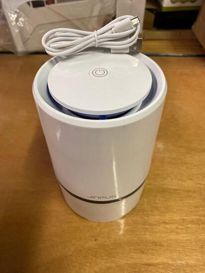Humidifier/ aircleaner
