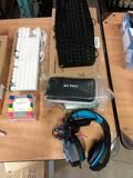 Two keyboards/3 1/2 disks/ Gaming headset/3D pen
