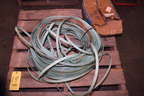 """LOT CONSISTING OF: 3/4"""" plastic banding material & (one box) strap clips"""