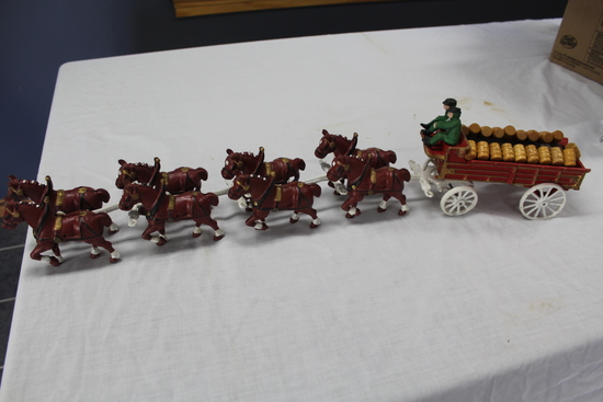 CAST IRON 8 HORSE WAGON WITH 2 MEN AND DOG,