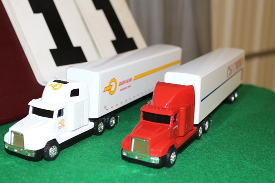 (2) 1/64 FREIGHTLINER SEMIS WITH TRAILERS,
