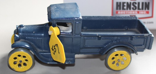 BLUE CAST IRON TRUCK WITH MAN, HAS PAINT CHIPS