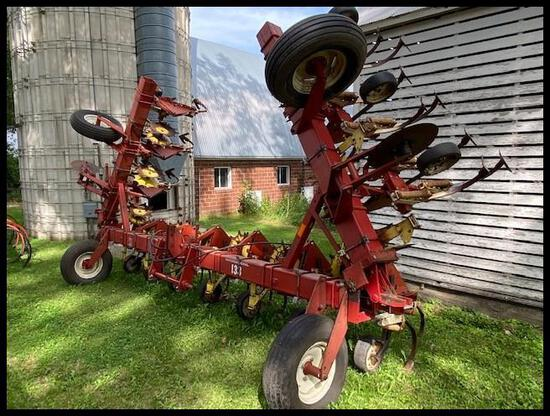"IH 133 12R30"" Cultivator, Rolling Shields, Wing Fold, wings lift slightly when in operation"