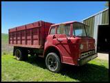 ***Ford 750 Single Axle Truck, 15' Knapheide Steel Box, Hoist, 126093 miles, 5+2, 9.00-20 on Spokes,