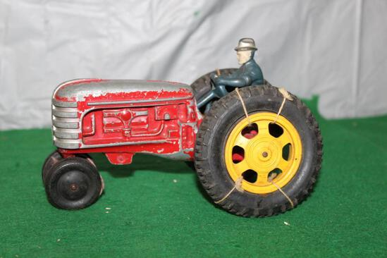 MASSEY HARRIS TRACTOR WITH MAN, PAINT CHIPS, TIRES ARE LOOSE, NO BOX