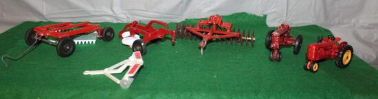 1/43 MASSEY HARRIS TRACTOR, 2 BOTTOM PLOW, RAKE, (2) DISKS, AND A TRACTOR