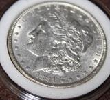 1881 MORGAN SILVER DOLLAR, ALMOST UNCIRCULATED
