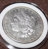 1879 S MORGAN SILVER DOLLAR, ALLMOST UNCIRCULATED