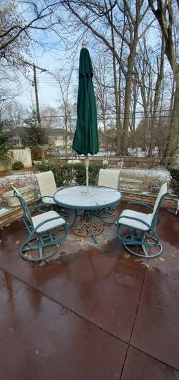 PA- Outdoor Metal Glass Top Metal Table with (4) Swivel Rocking Chairs with Umbrella