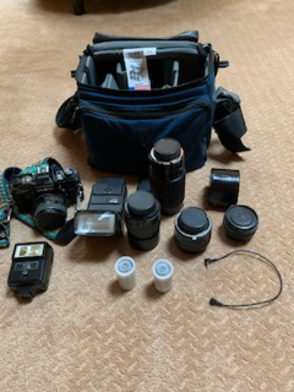 35 millimeter camera with lenses, bag, film and accessories.