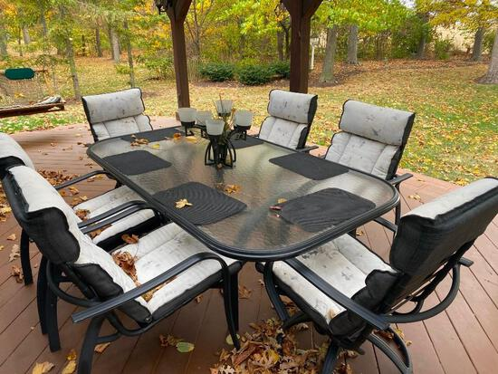 Outdoor Table with (6) total chairs, and cushions