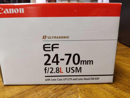 B- Canon EF 24-70mm