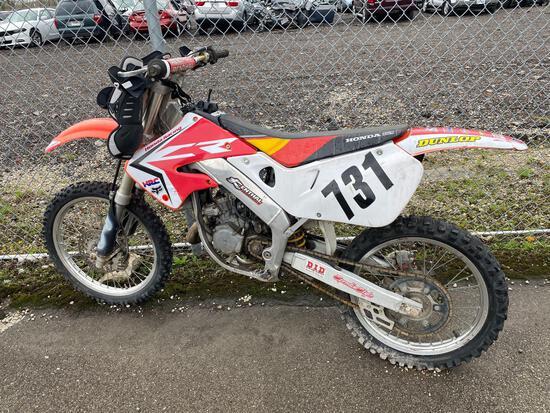 1999 Red Honda CR125R Motorcycle