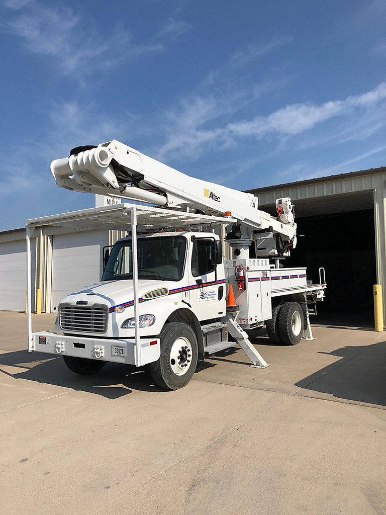(Schuyler, NE) Altec TA60, Articulating & Telescopic Material Handling Bucket Truck center mounted o