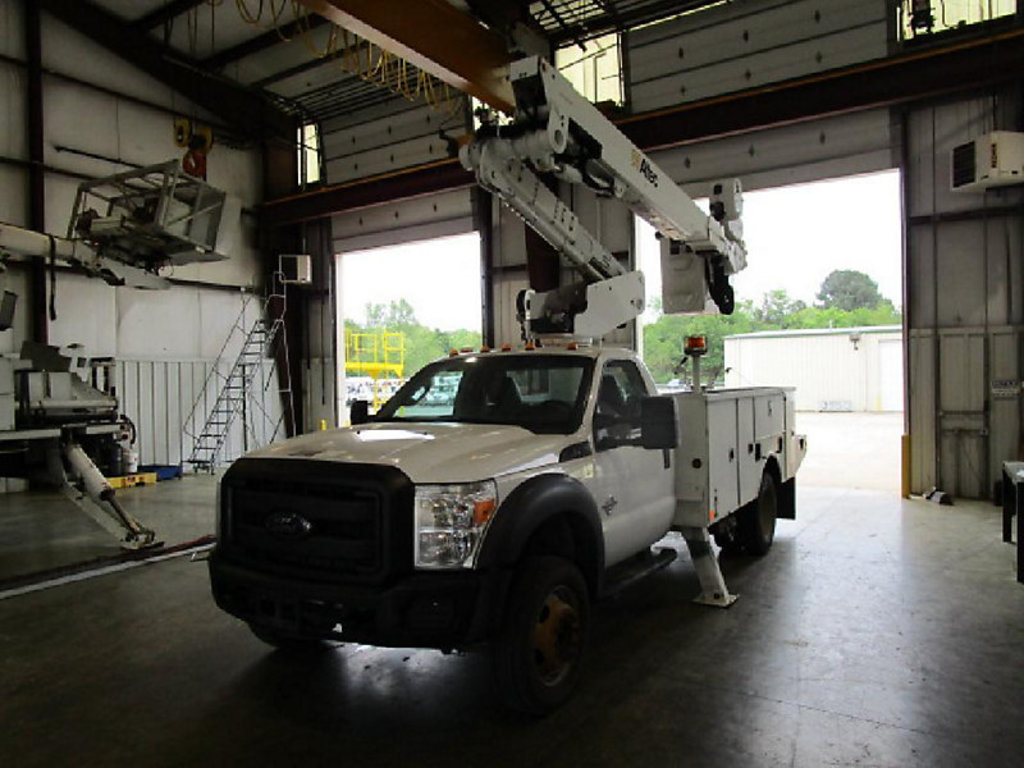 (Conway, AR) Altec AT40M, Articulating & Telescopic Material Handling Bucket Truck mounted behind ca