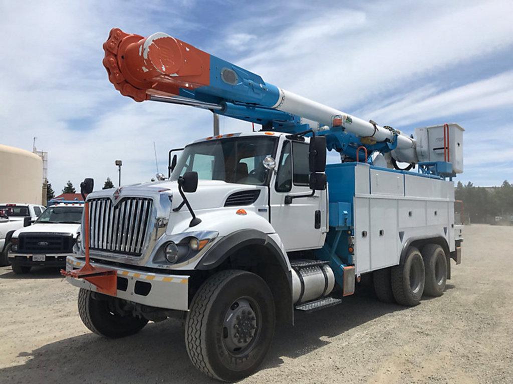 (Dixon, CA) Altec AM55, Over-Center Material Handling Bucket Truck rear mounted on 2012 Internationa