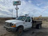 (Wright City, MO) 2001 Ford F550 4x4 Flatbed/Service Truck Hard start, runs, drives.