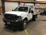 (Neenah, WI) 2002 Ford F350 4x4 Dump Truck runs and drives, seller states (transmission fluid leak),