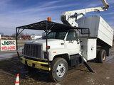 (Charlotte, MI) HiRanger XT55, Over-Center Bucket Truck mounted behind cab on 2001 GMC C7500 Chipper
