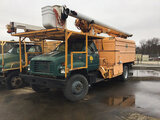 (Conway, AR) Altec LRIII, Over-Center Bucket Truck mounted behind cab on 1998 GMC C6500 Chipper Dump