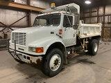 (Neenah, WI) 1999 International 4900 Dump Truck runs and drives, dump operates