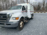 (Hagerstown, MD) 2010 Ford F750 Extended-Cab Chipper Dump Truck runs and drives, dump body operates,