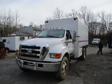 (Harmans, MD) 2007 Ford F750 Chipper Dump Truck Starts, runs and operates. Right side hood damage.