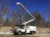 (Shrewsbury, MA) Altec LRV-56, Over-Center Bucket Truck mounted behind cab on 2010 Ford F750 Chipper