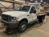 (Neenah, WI) 2002 Ford F350 4x4 Dump Truck runs and drives, brake light on (pedal soft), dump box op