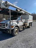 (Hagerstown, MD) Altec LRV56, Over-Center Bucket Truck mounted behind cab on 2010 Ford F750 Chipper