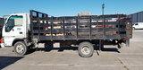 (Corpus Christi, TX) 2006 Isuzu NPR Cab Forward Stake Truck runs, drives, body damage, curbside door