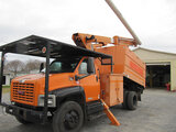 (Shelby, NC) Altec LRV-55, Over-Center Bucket Truck mounted behind cab on 2005 GMC C7500 Chipper Dum