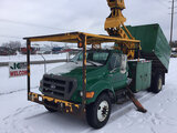 (Charlotte, MI) Altec LRV60-E70, Over-Center Elevator Bucket Truck mounted behind cab on 2006 Ford F
