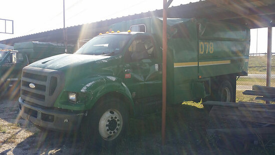 2008 Ford F750 Chipper Dump Truck wrecked, not running, condition unknown, bed full of chips, operat