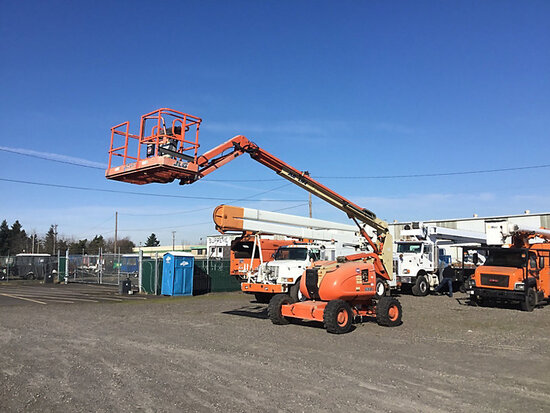1999 JLG 600AJ Self-Propelled Telescopic Manlift runs, operates, only one propane tank sold with uni