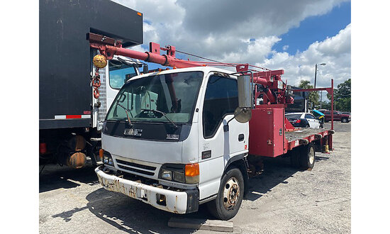 Skyhook Telescopic Sign Crane rear mounted on 2001 GMC W4500 Flatbed Truck, Used for installing sign