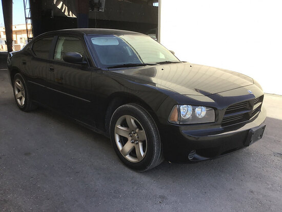 2010 Dodge Charger 4-Door Sedan Runs and drives, windows need repair will not roll down, stripped of