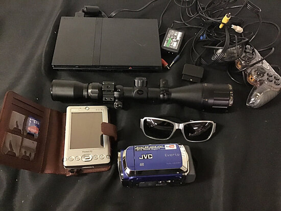 PlayStation 2 with controller missing part of power plug | sunglasses | jvc camcorder | Dell pocket