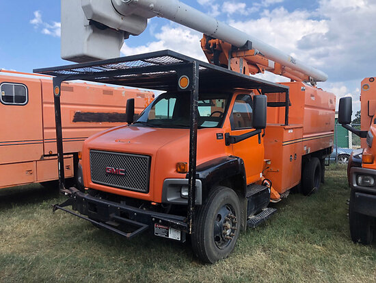 Altec LRV-56, Over-Center Bucket Truck mounted behind cab on 2009 GMC C7500 Chipper Dump Truck