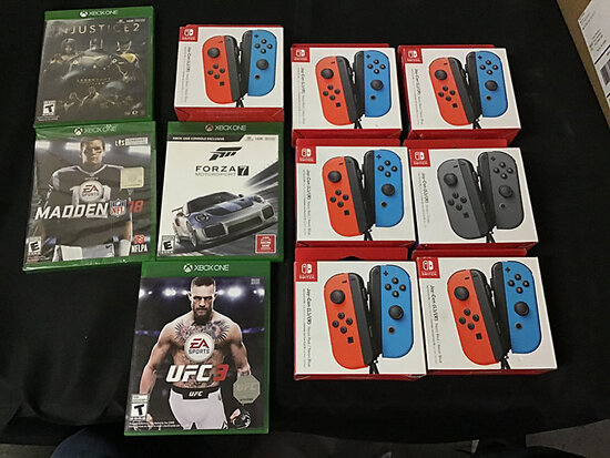 7 new in box Nintendo switch controllers   4 Xbox one games NOTE: This unit is being sold AS IS/WHER