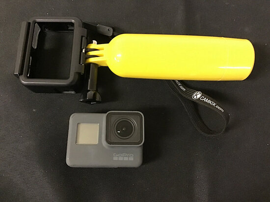 Go pro hero 5 with battery   housing case and hand grip (Used ) NOTE: This unit is being sold AS IS/