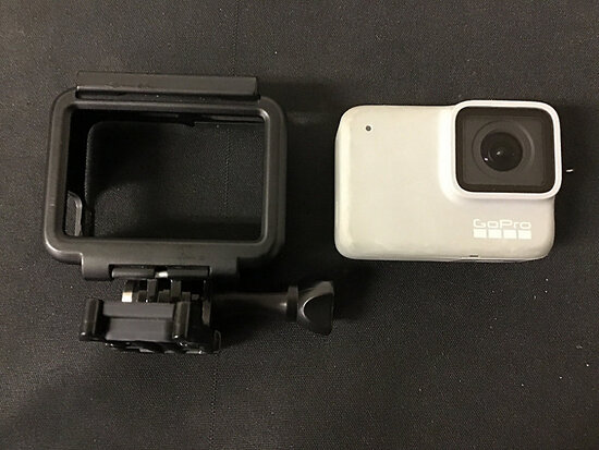 Go pro 7 white with protective housing case   no plugs (Used ) NOTE: This unit is being sold AS IS/W