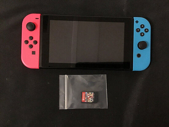 Nintendo switch with 1 Mario kart game   no plugs (Used ) NOTE: This unit is being sold AS IS/WHERE