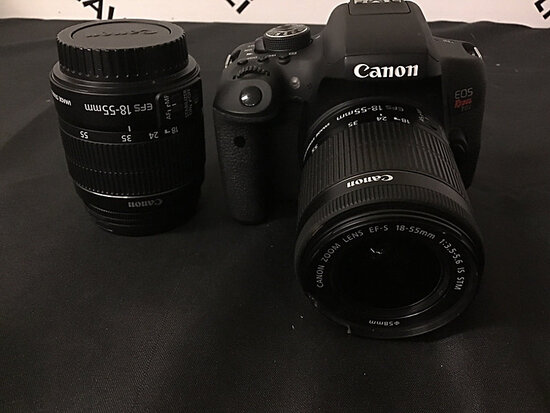 Canon eos rebel T6i digital camera   has battery and extra lens   no charger or plugs (Used ) NOTE: