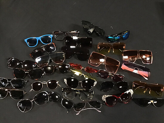 Assorted sunglasses (Used) NOTE: This unit is being sold AS IS/WHERE IS via Timed Auction and is loc