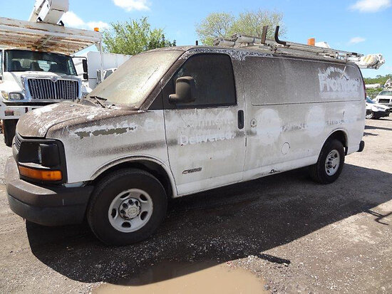2005 Chevrolet G2500 Cargo Van runs and moves, minor body damage.