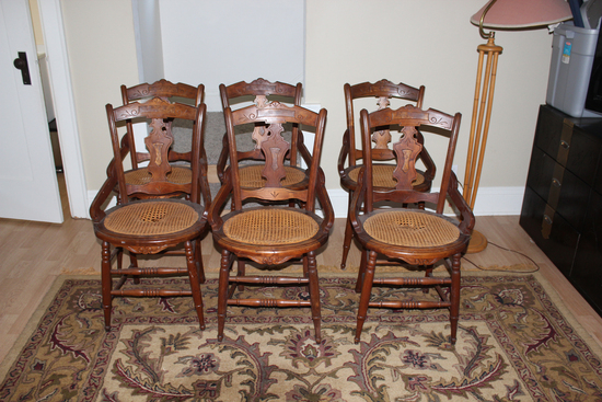 Set of 6 hip hugger Victorian walnut cane bottom chairs some rough caning