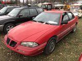 1992 PONTIAC GRAND AM 4-DOOR SEDAN, 3600 V6 GAS ENGINE, AUTO TRANS, CLOTH, PW, AM/FM-CD, REAR WHEEL